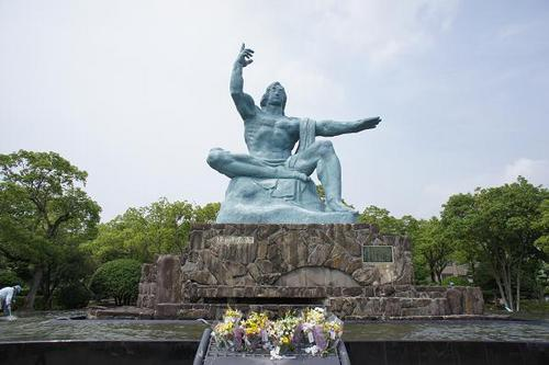 In one corner of 'Heiwa-koen', the Nagasaki Peace Memorial Park, that is laid out at the epicenter of the A-bomb, 'Heiwa-kinenzo', the Statue of Peace is mercifully seated.