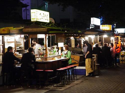 In Fukuoka, the largest city in Kyushu, a cluster of street food stands called 'yatai' appears here and there in the heart of the city when night comes.